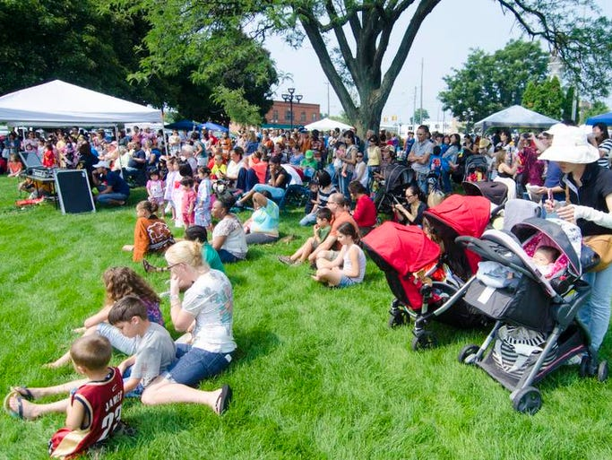 Crowds gather at McCamly Park for the International Summerfest and Black Arts Festival on Saturday, August 9, 2014.