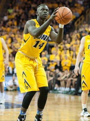 Iowa Hawkeyes guard Peter Jok (14) prepares to shoot a free throw against the Michigan State Spartans during the second half at Carver-Hawkeye Arena.