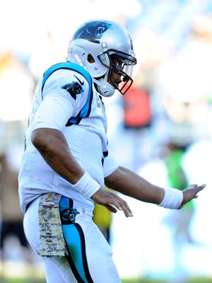 Panthers quarterback Cam Newton celebrates after a touchdown against the Titans on Sunday.