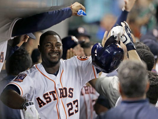 FILE - In this Saturday, May 16, 2015 file photo, Houston Astros' Chris Carter (23) is congratulated in the dugout after hitting a three-run home run against the Toronto Blue Jays in the sixth inning of a baseball game in Houston. Free-agent first baseman Chris Carter signed a one-year, $2.5 million contract with the Milwaukee Brewers on Wednesday, Jan. 6, 2016. (AP Photo/Pat Sullivan, File)