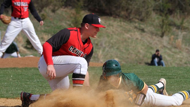 North Hunterdon's Shayne Fontana is safe in a dive back at first base as Hunterdon Central's Matt Toke tries to make the tag, in baseball action of North Hunterdon at Hunterdon Central in Flemington.