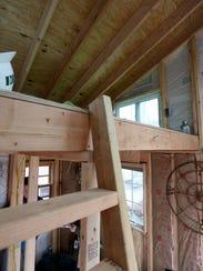 The loft bedroom of the tiny house Matthew Olson is