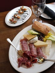Foreground: the cheese and charcuterie plate, with