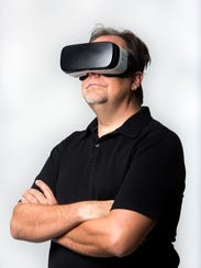 Jay Schlichter wears his VR headset in the Naples Daily