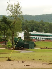 Debris cover the 18th Hole at The Old White TPC at
