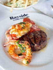 A filet with Florida gulf shrimp and lobster is served