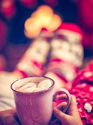 Adorable little kids are drinking hot chocolate for
