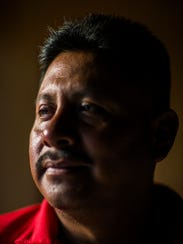 Juvenal Dominguez in his home in Fort Pierce, Fla., on July 10, 2017. Dominguez came to the U.S. from Mexico in 1998. He fractured his leg while working a construction job. His employer's insurance company reported him for prosecution under a Florida law that makes it a felony to use a false Social Security number to obtain a job or injury benefits. He was ordered to pay nearly $19,000 for benefits and expenses.