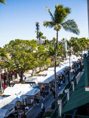 Tents line Fifth Avenue South during the 22nd annual Naples New Year's Art Show on Saturday, Jan. 6, 2018.
