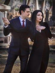 Gomez (Alec Ruiz) and Morticia (Lilianna Solum) are