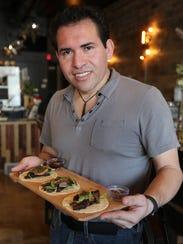 Chef Junior Merino of M Cantina in Dearborn shows off