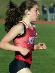 Haleigh Morales runs in the 3200 meter race on the