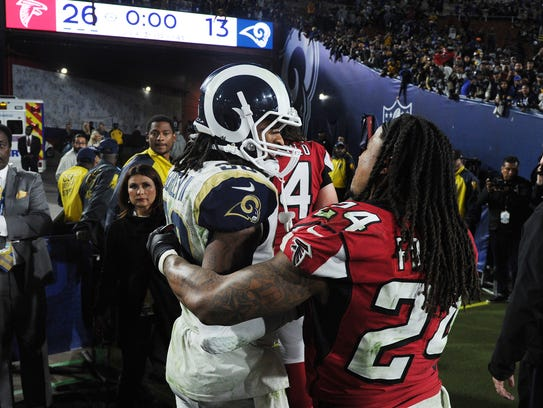 Rams running back Todd Gurley, left, and Falcon running