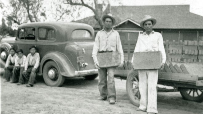 In this 1935 photo, workers carry adobe bricks which became part of the original St. Mary's Catholic Church on Chandler Boulevard.