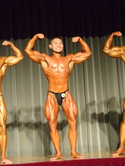 Bodybuilding class champions, from left, Jaime Rodriguez, Devin Chaco and Dan Munoz pose during the overall national championship judging at the 2015 Michelob Ultra Guam National Fitness Championships and International Invitational at the LeoPalace Resort ballroom on Saturday, Sept. 26, 2015.