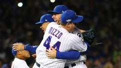 Anthony Rizzo and Kris Bryant celebrate after defeating