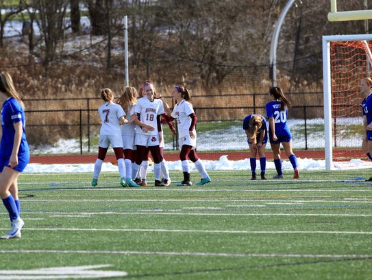 Aquinas celebrates after Alana Piano's goal 85 seconds into the state championship game on Sunday.