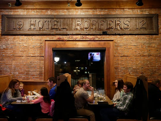 The sign inside Brickhouse is original to the 104-year-old