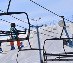 Skiers take to the slopes at Powder Ridge Ski Area during the early years of the Kimball ski hill. Powder Ridge is celebrating its 60th anniversary Saturday.