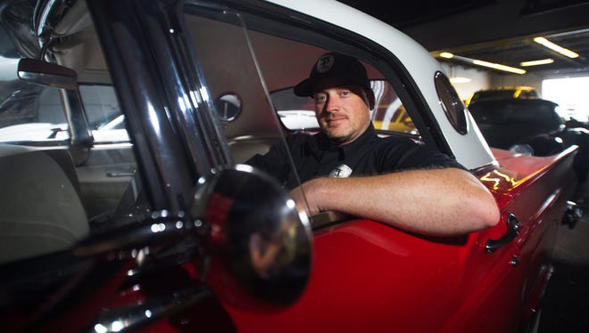 Tommy Pike, owner of Tommy Pike Customs, sits in the front seat of a 1957 Ford Thunderbird he recently restored on Friday, May 20, 2016.