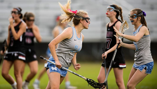 JL Mann's Annie Zemp, left, celebrates with Elouise Ursy after scoring against Wando during the teams' Class AAAAA state semifinal match on Wednesday, April 25, 2018.