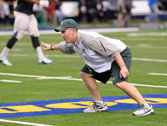 MSU assistant coach Mike Tressel  works with the linebackers