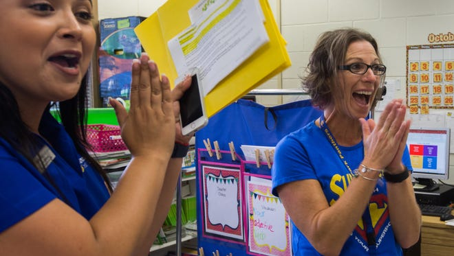 Jackie Rodriguez, left, a Champions for Learning volunteer, and Jennifer Plummer, right, a second-grade teacher at Lake Park Elementary, celebrated with Plummer's class after she received a classroom grant Friday, Oct. 7, 2016.