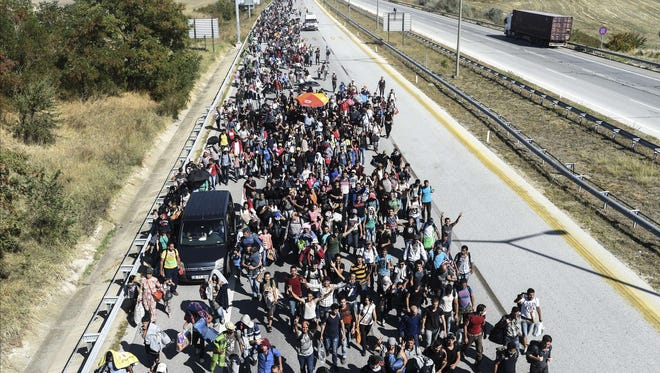 Syrian refugees march along a highway toward the Turkish-Greek border at Edirne on Sept. 18. Many fled the civil war raging at home.