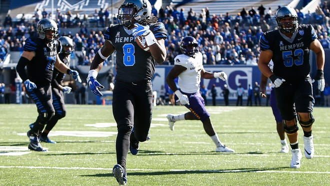 Memphis running back Darrell Henderson (middle) runs by the ECU defense for a touchdown during second quarter at the Liberty Bowl Memorial Stadium in Memphis, Tenn., Saturday, November 25, 2017.
