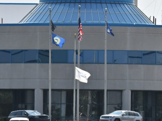 The FCA flag is flown at half mast in front of the Chrysler Jefferson North Assembly Plant in memoriam of Sergio Marchionne, the former head of Fiat Chrysler Automobiles, in Detroit on July 25, 2018.