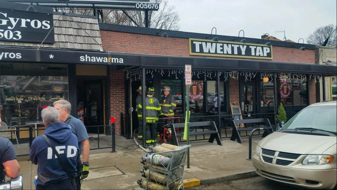 Indianapolis firefighters took 15 minutes to extinguish a kitchen fire at Twenty Tap, 5406 N. College Ave., Thursday, Feb. 23, 2017.