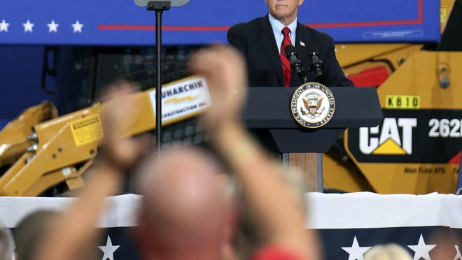 Vice President Mike Pence looks out over the audience of applauding supporters Tuesday during a rally at Kuharchik Construction Inc. in Exeter Pa.