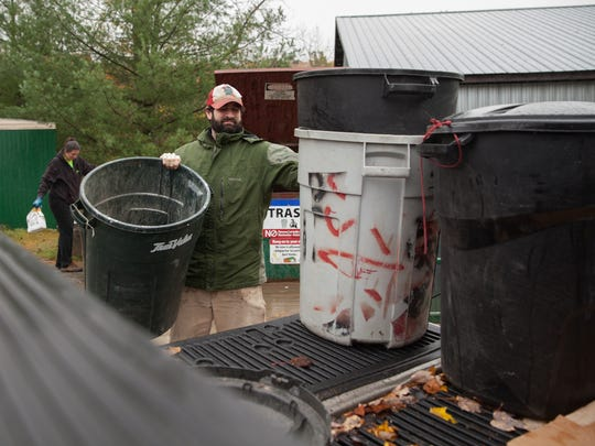 Noah Everitt drops off trash at the Chittenden County Solid Waste District site in Hinesburg on Saturday.