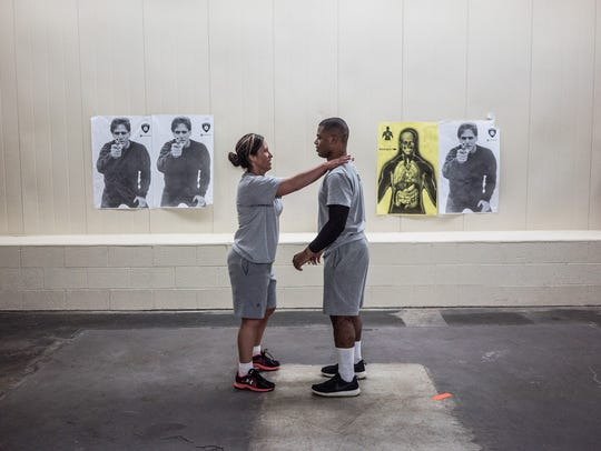 "In the Netflix documentary series ""Flint Town,"" police cadets DIon Reed, 20, and his mother Maria Reed train together at Mott Police Academy."