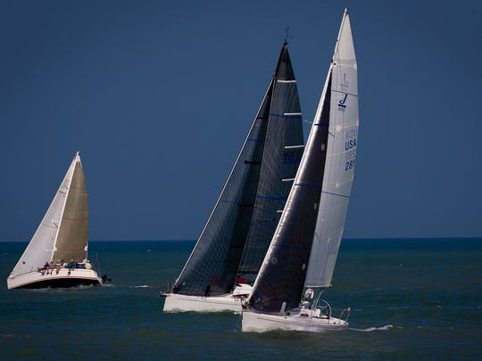 Participants sail in the 40th annual Southwest Florida Charity Regatta of the Gulf Coast Sailing Club in the Gulf of Mexico near the Naples pier on Saturday, April 2. 2016, in Naples.