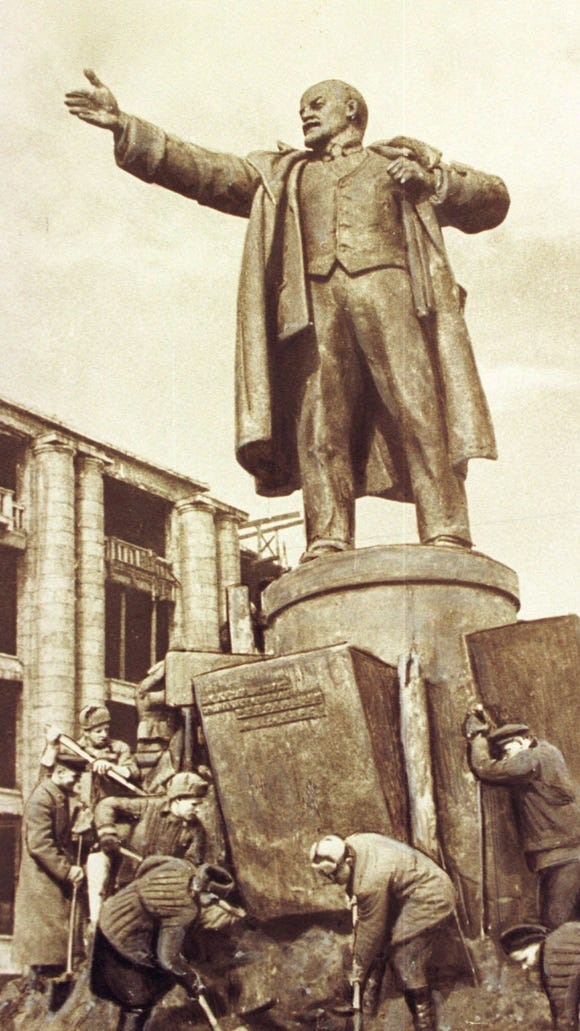 ADV. FOR SUN., JAN. 17--FILE--This is a 1946 file picture by Georgy Lugovoi, showing municipal workers erecting a monument to Vladimir Lenin in St. Petersburg, Russia. Lugovoy was born April 27, 1900 and lived most of his life in St. Petersburg, where he worked as a photographer. Lugovoi witnessed the 1917 Russian revolution, the Nazi siege of the city during W.W.II, and all the other tumultuous events that have rocked Russia this century. (AP Photo/Georgy Lugovoi)