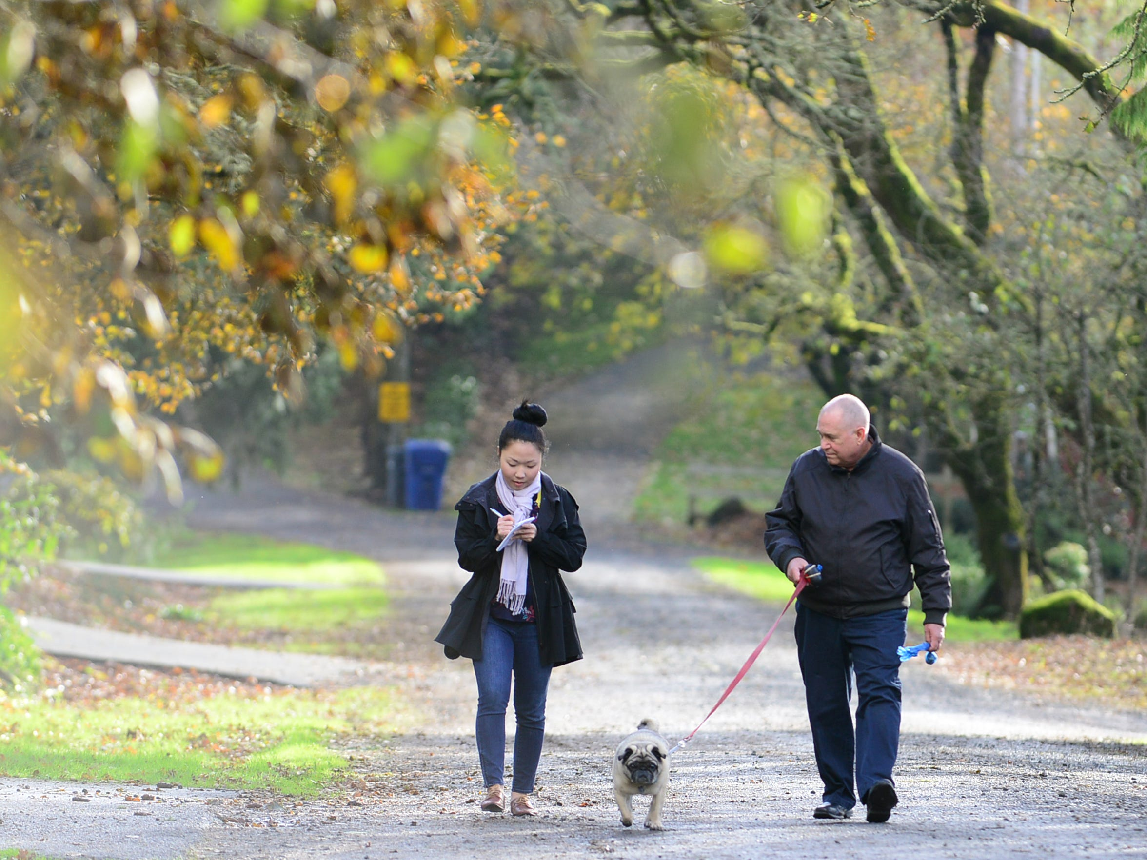 Reporter Saerom Yoo, left, interview Dr. Peter Rasmussen while on a walk with his dog, Pugsley, in Rasmussen's East Salem neighborhood. The retired oncologist and Death With Dignity advocate is facing his own demise from a brain tumor.