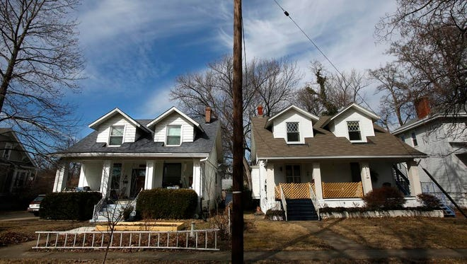 Amy Linfield and her husband live in the house on the left and rent out the house on the right.   Feb. 13, 2015