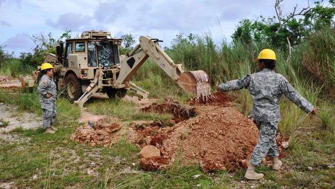 Guam National Guard members are shown working in Northwest Field recently.