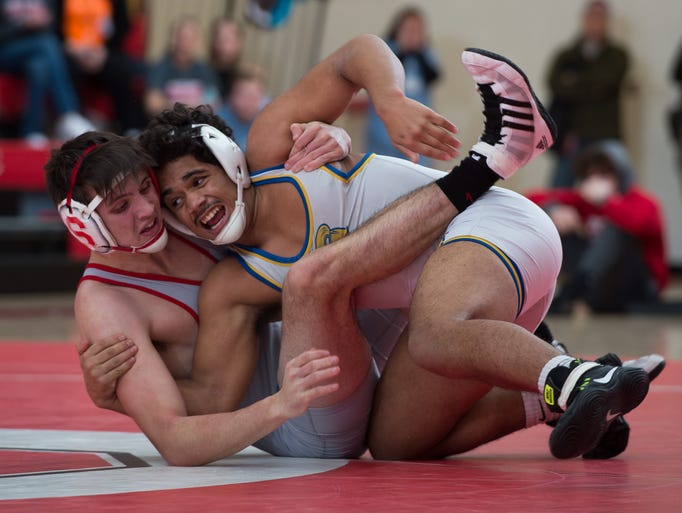 Sussex Central's Brandon Bautista, right, forces Smyrna's
