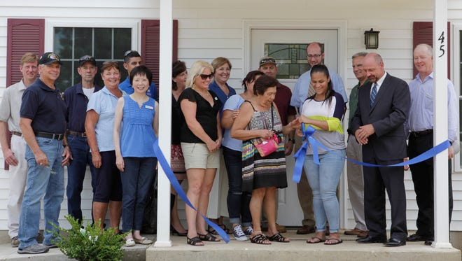 Ceremony for the finishing of four new Habitat for Humanity homes on Harding Ave. in Dover. 