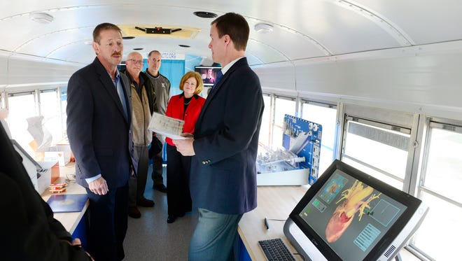 Tim Myers, left, general manager at Century Die Co., presented a $3,000 check to Vanguard-Sentinel Superintendent Greg Edinger for the school's mobile technology lab.