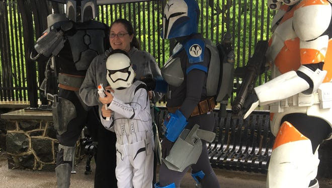Mason Dickinson, front center, poses with his great aunt Theresa Jones, and other Star Wars characters at the Brandywine Zoo's Star Wars costume day.
