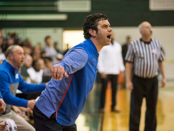 St. Clair High School head coach Shawn Sharrow shouts