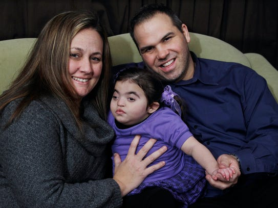 Chrissy and Joseph Rivera with daughter Amelia, then 3, in January, 2012.
