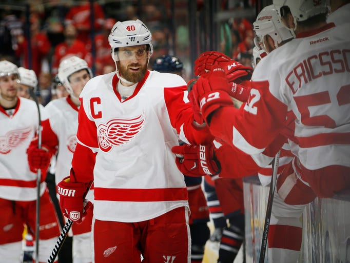 Teammates congratulate Detroit Red Wings left wing