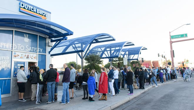 Dutch Bros on Camelback Road and Central Avenue was packed before the start of the Fiesta Bowl Parade on Dec. 30, 2017, in Phoenix.