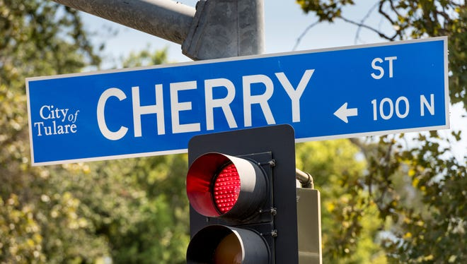 Crews continue work on the utility and street reconstruction project at Cherry Street and Tulare Avenue on Monday, July 16, 2018.
