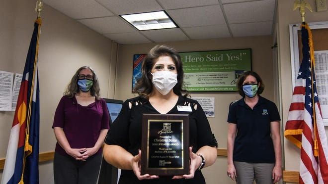 Donate Life America presented La Junta Driver License Office Manager Christina Salas (center) with the 2020 Lifesaver Award on Wednesday, Sept. 23, 2020, at the Colorado Division of Motor Vehicles office. Salas received the award for her work in raising organ, eye and tissue donation awareness in the Rocky Ford area. Pictured with Salas are DMV Region II Manager Shari Creason and Donor Alliance Public Education Coordinator Anne Gaspers.