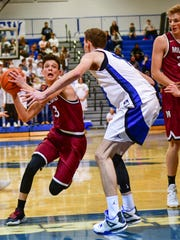 Milford's Aiden Warzecha (left) drives on Lakeland's